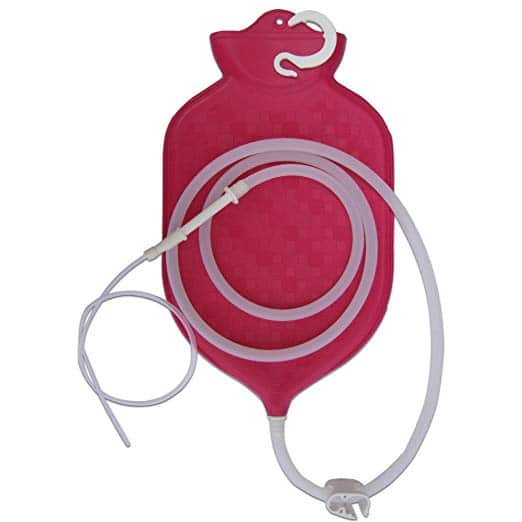 An upright bag and nozzle for colonic enemas
