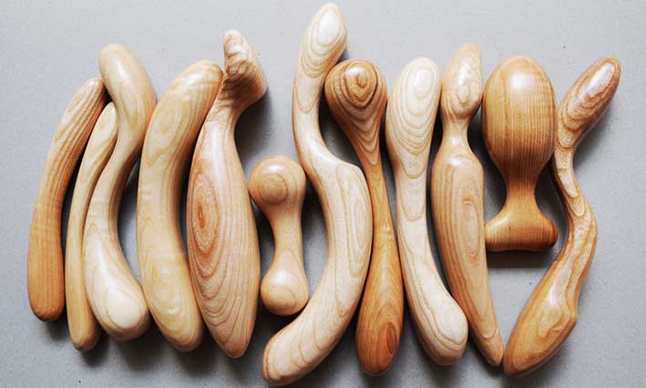 A collection of wood butt plugs and dildos